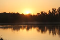 Sunrise over the river. Reflection royalty free stock image