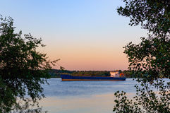 Sunrise over the river. River Don. Rostov region. Sunrise over the river. Barge in river Don. Rostov region Royalty Free Stock Photo