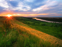 Sunrise over the river valley and beautiful sky with clouds Stock Photo