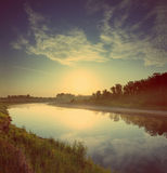 Sunrise over river - vintage retro style Royalty Free Stock Photography