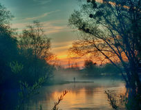 Sunrise over the river washing Stock Photography