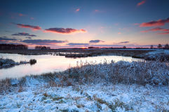Sunrise over river in winter Royalty Free Stock Image