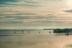 Sunrise over the river with yachts on a calm water surface Royalty Free Stock Images
