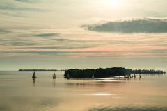 Sunrise over the river with yachts on a calm water surface Stock Photos