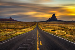 Sunrise over road to Monument Valley, Utah, USA Royalty Free Stock Photo