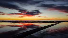 Sunrise over rock pool Stock Image
