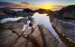 Sunrise over rocks Stock Photo