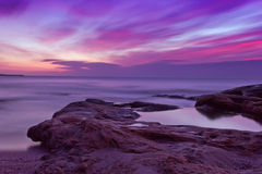 Sunrise over the rocky beach Royalty Free Stock Photo