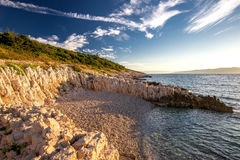 Sunrise over the rocky beach in Istria, Croatia royalty free stock image