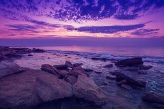 Sunrise over rocky beach Royalty Free Stock Photo