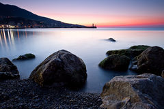 Sunrise over rocky black sea coastline Royalty Free Stock Photo