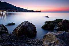 Sunrise over rocky black sea coastline Royalty Free Stock Photo