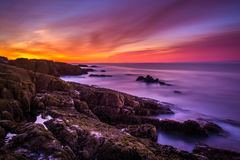 Sunrise over rocky coast and the Atlantic Ocean at Acadia Nation Royalty Free Stock Photo