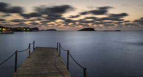 Sunrise over rocky coastline on Meditarranean Sea landscape in S Stock Photos