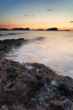 Sunrise over rocky coastline on Meditarranean Sea landscape in S Stock Photos