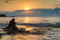 Sunrise over rocky coastline on Meditarranean Sea landscape in S Stock Photo