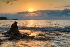 Sunrise over rocky coastline on Meditarranean Sea landscape in S Stock Photo