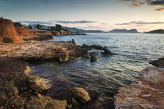 Sunrise over rocky coastline on Meditarranean Sea landscape in S Royalty Free Stock Photo