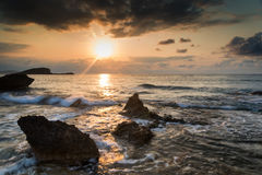 Sunrise over rocky coastline on Meditarranean Sea landscape in S Royalty Free Stock Images