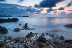 Sunrise over rocky coastline on Meditarranean Sea landscape in S Stock Images