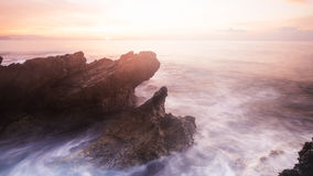 Sunrise over rocky coastline, Sicily, Italy Stock Photos