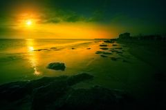 Sunrise over the rocky sea shore. Early morning, sunrise over the sea. Rocky sea shore stock photography