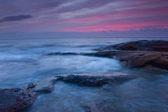 Sunrise over the rocky seashore Stock Images