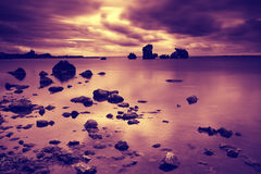 Sunrise over a rocky seashore Royalty Free Stock Image