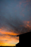 Sunrise over the roofs Stock Photography