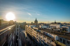 Sunrise over the rooftops in a city royalty free stock image