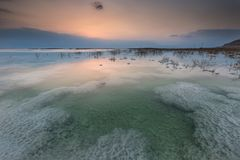 Salty sunrise. Sunrise over salty pools of the southern part of the Dead Sea, Israel Stock Images
