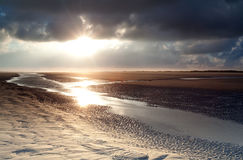 Sunrise over sand beach on North sea Royalty Free Stock Photo