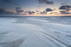 Sunrise over sand beach on North sea Stock Images