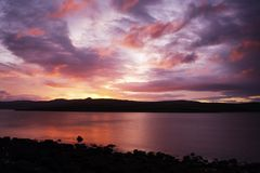 Sunrise over Scottish Loch Royalty Free Stock Photos