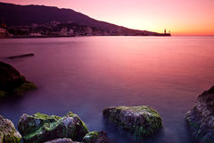 Sunrise over sea. Rocky beach sunrise over sea Royalty Free Stock Photography