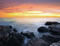 Sunrise over sea. With rock coast stock photos
