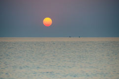 Sunrise over  Sea. Sunrise over fishermen boats on the sea Stock Photos
