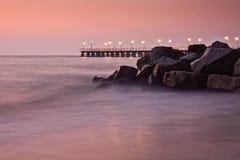 Sunrise over the Sea. Sunrise over the Baltic Sea, pier at the seaside Stock Photo