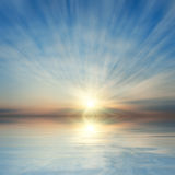 Sunrise over sea. Beautiful sunrise over sea with reflection in water, majestic clouds in the sky Stock Photography