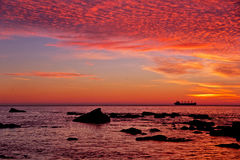 Sunrise over the sea. Amazing seascape sunrise over the sea with ship at horizon Stock Photo