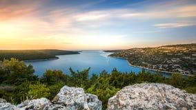 Sunrise over the sea bay Istria Croatia. Sunrise over the sea in summertime over the Raša bay in Croatia on the Istria peninsula with turquoise water royalty free stock images