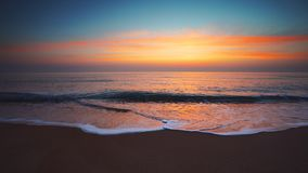 Sunrise over the sea and beach. Waves washing the sand. stock video