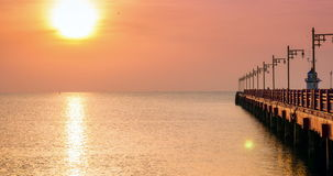 Sunrise over the sea with bridge and lighthouse stock footage
