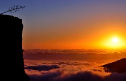 Sunrise over the sea of clouds Royalty Free Stock Image