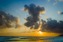 Sunrise over the sea in the clouds Stock Photo