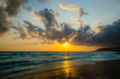 Sunrise over the sea in the clouds Royalty Free Stock Images