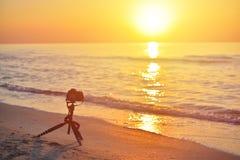Sunrise over the sea coast. Fireball of the sun above the horizo Stock Photos