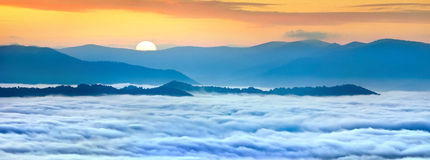 Sunrise over the sea of fog. In the mountains at the summer Stock Photography