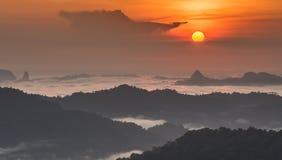 Sunrise Over Sea fog and mountain Stock Image