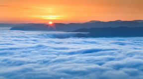 Sunrise over the sea of fog in the mountains Stock Photography